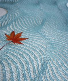 sound of waves- i could wrap myself up in the sea.  1 skein, easy lace pattern