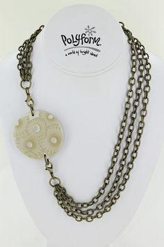 This asymmetrical necklace is designed to be worn to one side.  Designed by Amy Koranek
