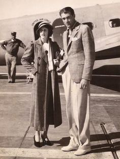 """coop-appreciation: """" Gary Cooper and his girlfriend Sandra Shaw at the LA Airport on Nov 11th 1933. The rumor was that Gary and Sandra were to be wed soon. There is a United Airlines airplane in the..."""