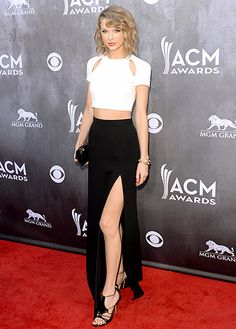 Taylor Swift shows a peek of skin in a J Mendel dress and Casadei shoes at the 2014 ACM Awards