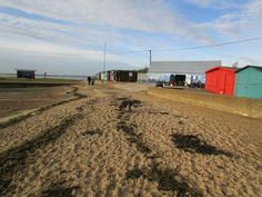 Brightlingsea.. Blue Cafe .. With Storm Dog on beach ... Taken by Debra Betts