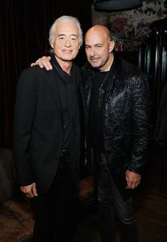 Musician Jimmy Page and designer John Varvatos pose for a photo as John Varvatos celebrates the launch of 'JIMMY PAGE By Jimmy Page' at John Varvatos 315 Bowery Boutique on November 6, 2014 in New York City.