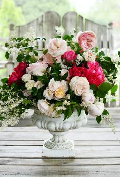 Flower arrangement in urn with garden roses | ©homeiswheretheboatis.net #flowers #roses Garden Urns, Garden Roses, Diy Vanity Lights, Picket Fence Panels, How To Make Gingerbread, Old Washing Machine, Paint Stir Sticks, Garden Markers, Floral Foam