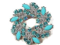 Stunning Blue Crystal Pin Brooch Nestled in Silver Tone Leaves