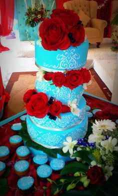 Love the blue with cake & cupcakes with red flowers or with some kind of red accent