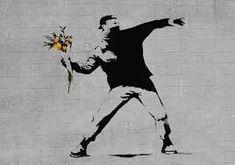 """""""Love is in the air"""" (2002). Un jove manifestant que es tapa la cara per no ser reconegut es troba en posició de llençar un còctel molotov. En canvi, entre les seves mans sosté un ram de flors. Banksy juga amb la ironia i introdueix un element inesperat en un context on ràpidament crida l'atenció de l'espectador, que de seguida entén la contradicció que es genera entre el personatge i l'objecte."""