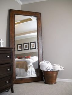 leaning mirror in corner. Really want this. Decorative and functional... so much prettier than my full length mirror on the wall!