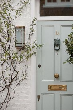 Pale blue front door color with white brick exterior Grey Front Doors, Painted Front Doors, The Doors, Front Entry, Painted Exterior Doors, Painted Brick Exteriors, Victorian Front Doors, Small Doors, Front Door Paint Colors