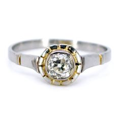 Binenbaum Antiques & Jewelry - This delicate solitaire ring feature ±0.50ct. (I VS1) Cushion Cut Diamond crafted in Platinum and 14ct. Design Era: Art Deco (1915-1935). Materials: Diamond, Platinum, 14ct. Size: 16.51 NL / 51.9 FR / 6 US / L½ UK, sizeable (within reason). Weight in grams: 2,4. Condition: Very good condition - slightly used with small signs of wear.