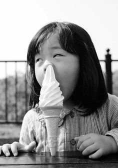 How the hell did that little girl produce soft serve ice cream from her nose?  Wonder how much she charges for a chocolate and strawberry double decker?