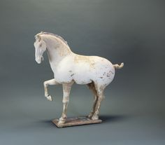 Horse with Raised Right Foreleg, Tang Dynasty, 618-907AD, China, Pottery with Traces of Paint