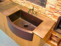 Rounded Front Copper Farmhouse Sink, with a copper countertop! Photo courtesy of a valued CopperSinksOnline.com customer!