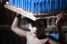 Aug. 29, 2013. Rocky, 7, working in a balloon factory in Dhaka, Bangladesh.
