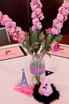 Printable Adorable Paris Party-  I like the striped paper on the vase. Add a pink ribbon to multiple vases all over the house. Perfect!