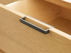 The Handles Intersect Drawers To Become A Part Of The Overall Function ... it could be possible to make these handles just from looking at this picture, they are probably screwed to the drawer on the inside of the drawer with two holes drilled into the metal for the screws.