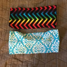 Spandex headbands Sold as a set. One is black with rainbow striping and the other is blue with white print. Both are BondBand brand and fitted at the bottom hairline for a comfy fit. Never worn Bondband Accessories Hair Accessories