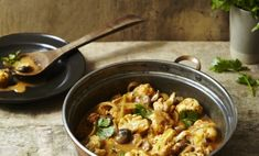 Cauliflower and mushrooms make an unlikely, albeit delicious, pair in this vegetarian, Paleo-friendly curry dish.