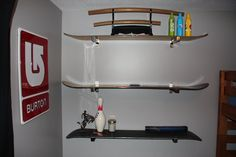 Shelves made from old snowboards and shelf brackets from Ikea