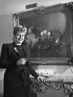 Eva Peron, Wife of Argentinian President Candidate, Holding Glass of Champagne in Her Apt