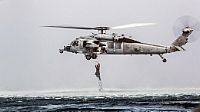 AT SEA, Indian Ocean (Nov. 28, 2016) A Marine with the Maritime Raid Force climbs a caving ladder attached to an MH-60 Sea Hawk during a helocast training evolution near the USS Makin Island (LHD 8) afloat in the Indian Ocean. The training consisted of Marines jumping out of CH-53