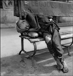'Man sleeping / dying on a loaf of bread', Werner Bischof 1947 XXY