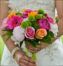My bridal bouquet from our Canadian wedding reception on June 9, 2012! I love the different pink hues with the roses, peonies and gerbera daisies. I used the green button mums, green trick and stem wrap to compliment my bridesmaids' dresses.