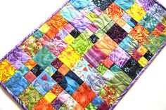 Patchwork Table Runner in Colorful Batik Fabrics, Tropical Quilted Wall Hanging by MyBitOfWonder on Etsy https://www.etsy.com/listing/545639352/patchwork-table-runner-in-colorful-batik