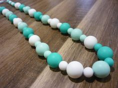 Turquoise, mint and white silicone teething nursing necklace - chewable fun for Bub and funky attire for Mum. Great baby shower present! on Etsy, $25.00 AUD