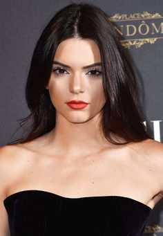 Kendall Jenner kept her makeup simple with a bold red lip and glossy strands