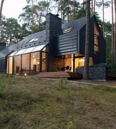 Percolating through the forest house and every aspect of its design, the Black House Blues brings the love for blues music through each space, and the functions and sharing it supports. Located in Kulautuva in Lithuania, this village house is a complex overlay of idea, ambition and desire  all morphed into a well contained and refined architectural vocabulary.