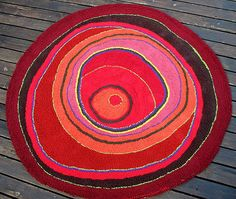 This is a hooked rug. I think it's latch hooked but it can also be locker hooked. Love the flowing, undulating circles in the design. Great colors! From Miele site.