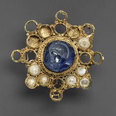 Star-Shaped Brooch with Intaglio, setting 960–1000, intaglio 337–361  Ottonian (setting), Byzantine (intaglio)  Gold with pearls and star sapphire