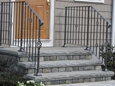 "http://www.stepguys.com/ fieldstone veneer on the sides and risers under what appears to be a 3"" solid granite tread."