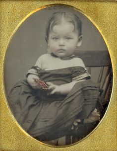 Baby holding a dag case  9th plate daguerreotype