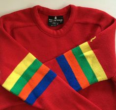 Vintage Ski Sweater Demetre - Cherry Red w Rainbow Stripes on Sleeve! - Downhill Skiing or Skating - 100% Wool - Very Cool Sweater by VintageByBeth on Etsy https://www.etsy.com/listing/255666639/vintage-ski-sweater-demetre-cherry-red-w