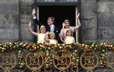 Newly-crowned Dutch King Willem-Alexander and Queen Maxima appear on the balcony of the Royal Palace with their children, from left: Catharina-Amalia, Ariane, and Alexia in Amsterdam, The Netherlands, on April 30, 2013. (AP Photo/Dusan Vranic)