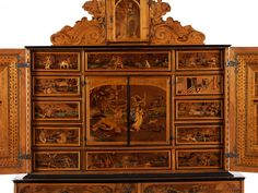 Augsburg cabinet with inlays Height: 198 cm. Width: 120 cm. Depth: 55 cm. Ca. 1590 / 1600. With key.
