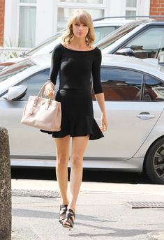 Taylor Swift Hits London in a Sexy Black Crop Top and Skirt! Shop Her Matching Set Now  #InStyle