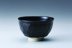 "Miraku Kamei XV Tea bowl (chawan), with faceted surface and black glaze, Stoneware, 2.75 × 4.75 × 4.75"", XV19"