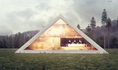 An Unusual Pyramid-Shaped House With A Gorgeous Glass Facade