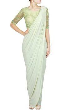 Featuring a green three piece saree set with beaded blouse, silk cigarrete pants and jersey pre-stitched saree drape by BHAAVYA BHATNAGAR Shop now-www.carmaonlineshop.com  #carma #carmaonlineshop #style #fashion #designer #indianfashion #indiandesigner #B