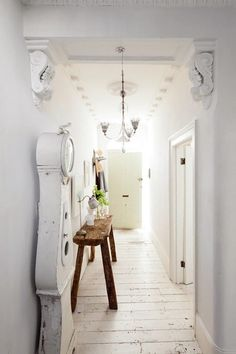 This house is in London, England.  The hallway leading into the house.  Note the floorboards.  Very shabby chic look.