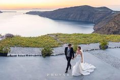 An incredible shot of Lily's beutiful wedding in Santorini. Captured by the incredible @studiophosart @lecielsantorini . . . Repost @lilyousby Sunset dreaming  #mrandmrsousby #weddinginsantorini