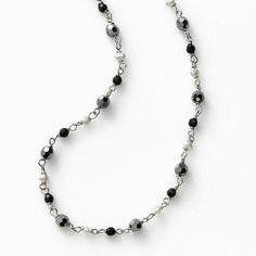 Gleaming beads of faceted Black Agate, crystal, and fresh water pearls alternate on delicate sterling silver necklace. Wear long & loose, wrap around twice, or layer  | Black and White | Fortunoff Fine Jewelry