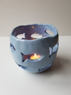 Candle or Tealight holder ceramic bowl with fish cutouts £ Candle or Tealight holder ceramic bowl with fish cutouts £ Ceramic Clay, Ceramic Bowls, Ceramic Pottery, Pottery Art, Ceramic Pinch Pots, Ceramic Fish, Pottery Painting, Diy Clay, Clay Crafts
