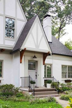 Tudor style home remodel with wood brackets, rain chain and muted exterior trim details. - Tudor Houses 4 U Tudor Exterior Paint, Tudor House Exterior, Exterior Paint Colors For House, Exterior Siding, Exterior Remodel, Paint Colors For Home, Exterior Design, Grey Exterior, Siding Colors