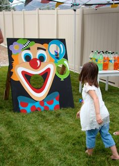 Circus party games: bad link, but keeping the pin for the fun clown been bag toss board idea.