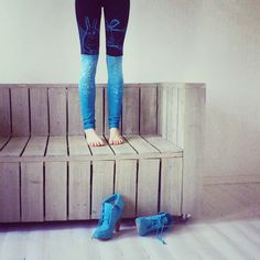wooden couch on casters