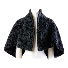 Vintage Black Russian Lamb Cape Wrap | From a collection of rare vintage coats and outerwear at http://www.1stdibs.com/fashion/clothing/coats-outerwear/