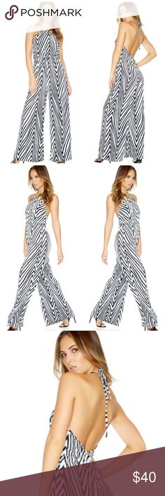 Halter Jumpsuit Halter Jumpsuit  Sleeveless wide leg halter jumpsuit with abstract print.   100% Polyester  Made in USA symphony Pants Jumpsuits & Rompers
